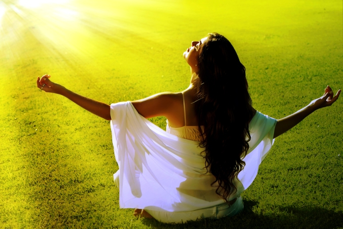 Meditation in a green field, Source: Bigstock