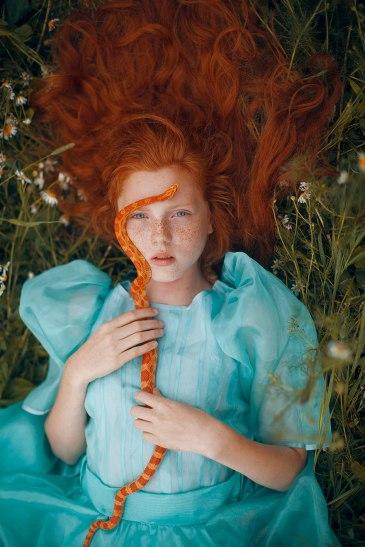 red_hair_girl_orange_snake
