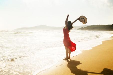 stock-woman-beach-thankful-gratitude-happiness-joy-celebrate-armsup-4c3w